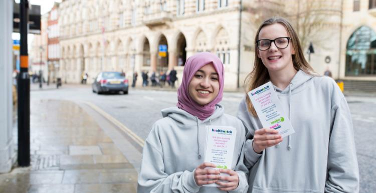 two young volunteers with leaflets