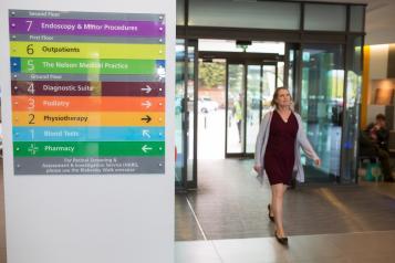 Woman entering hospital