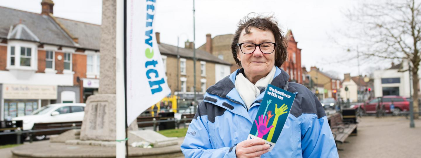 woman with healthwatch leaflet